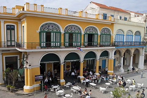 People sitting outside and live music at Taberna de la Muralla Brewery Bar and Restaurant on Plaza Vieja, City of Havana, Havana, Cuba